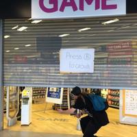 Video game store makes fun of broken door